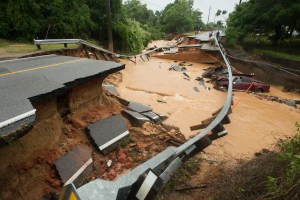 Damage due to flash flooding is seen along Johnson Ave. in Pensacola