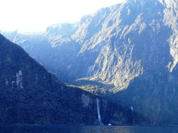 milford-sound-waterfall-and-boat