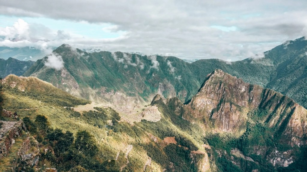 The view of Machu Picchu mountain and ruins as seen from the sun gate.