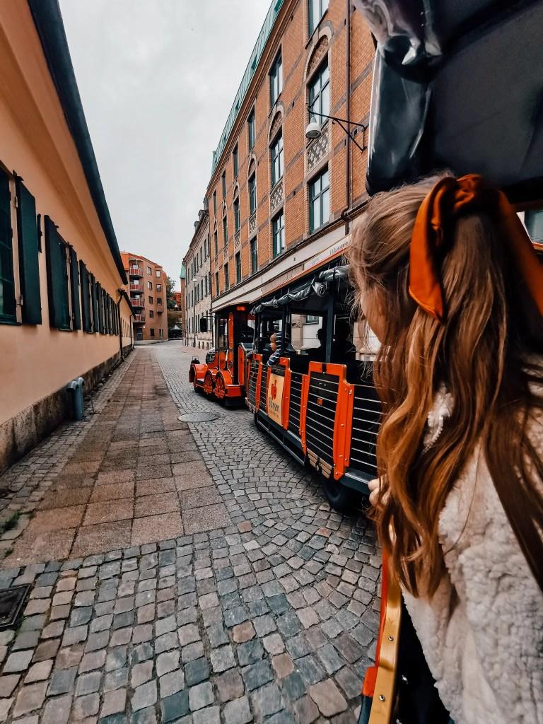 A woman taking an old tram through Gothenburg, Sweden.