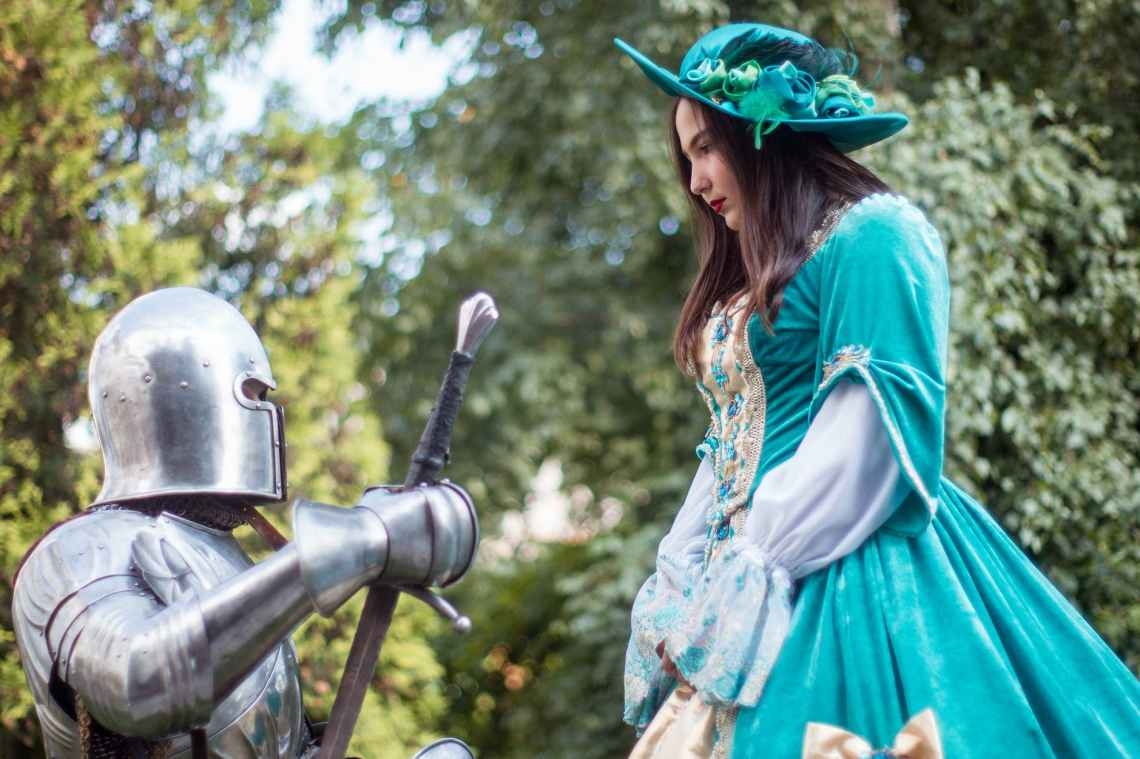 knight in front of woman in green dress