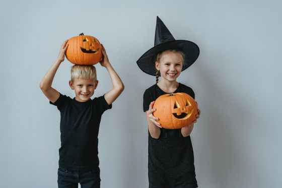 boy and girl holding jack o lantern