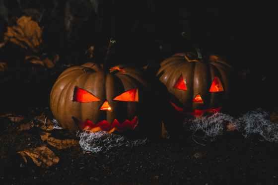 two jack o lantern lamps