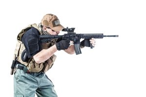 Studio shot of private military contractor PMC with assault rifle