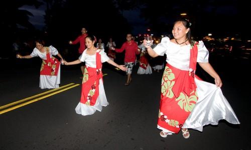 The Hilo Visayan Club dances their way through Hilo during the Lehua Jaycees Island Style Christmas parade.