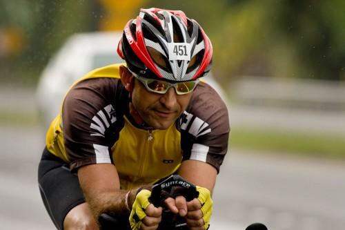 Triathlete Peter Mueller rides along rainy Kanoelehua Avenue in Hilo during day two of the 2008 Ultraman Triathlon.