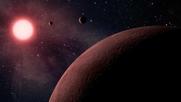 This artist's conception shows the KOI-961 planetary system. The system hosts the three smallest planets known to orbit a star beyond our sun (called KOI-961.01, KOI-961.02 and KOI-961.03). The smallest of these planets, KOI-961.03, is about the same size as Mars. All three planets take less than two days to whip around their star. Illustration courtesy of Caltech