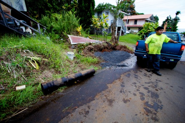 A pipe brought in to effect repairs was not used since it was a coupler and not the water main itself which was damaged. The repaired area is under the gravel covering the top of the filled trench used to access the break. Photography by Baron Sekiya   Hawaii 24/7
