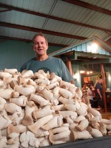 Stanga stands with freshly harvested Ali'i mushrooms (Hawaii 24/7 photo by Roya Sabri)