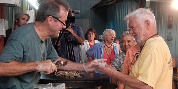 Stanga serving visitors a special mushroom recipe (Hawaii 24/7 photo by Roya Sabri)