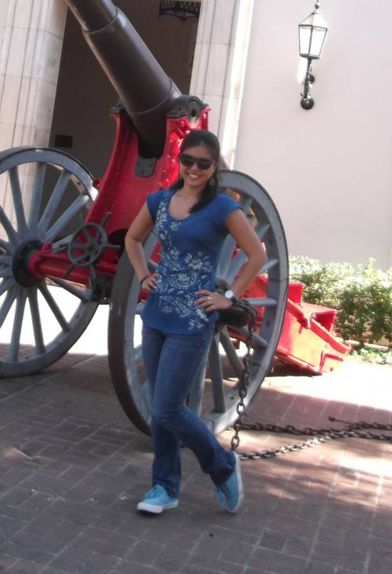 Parker School student Lysha Matsunobu stands next to the Caltech Cannon in Pasadena during her Summer Science Program. (Photo courtesy of Parker School)