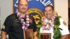 Sergeant James Correa, at left, and Captain Darwin Okinaka display plaques from the Aloha Exchange Club of East Hawaiʻi honoring them as 'Officer of the Year' and 'Firefighter of the Year.'