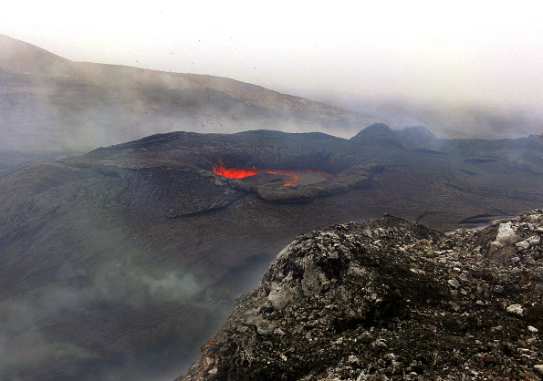 A closer view of the lava pond in the northeast portion of Puʻu ʻŌʻō crater Monday (April 7, 2014). The lava pond has partially closed over the past several weeks, and today was about 5 meters (yards) in diameter - about half of the diameter from two weeks ago. The pond was spattering, with small bits of airborne spatter visible in this photograph. Photo courtesy of USGS/HVO