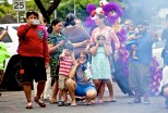 The crowd watches fireworks along with lion dancers, percussion music and a firebreather in downtown Hilo Chinese New Year's celebration. Photography by Baron Sekiya   Hawaii 24/7