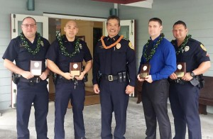 Chief Harry Kubojiri congratulates East Hawaiʻi Officers Gregg Karonis, Bryson Miyose, Jacob Obermiller and Erhard Autrata.