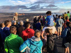 Park Ranger addresses large group of visitors at Jaggar Museum observation deck. Photo courtesy NPS