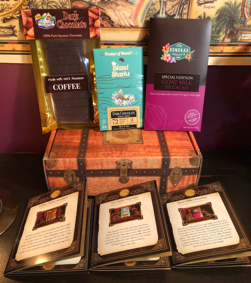 Hawaii Cacao Express, Chocolate Trunk, May 2021, three featured chocolate bars and booklets