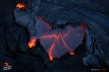 Lava oozes from beneath the hardened crust, as overplating occurs on the upper flow field.