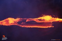 Pu'u 'O'o's lava pond was quite active, its hardened surface fracturing as the magma beneath circulates, drawing slabs of the crust back into its fiery depths.