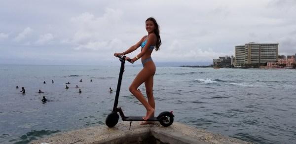Girl on GOTRAX electric foot kick scooter in Waikiki - Hawaii Powersports