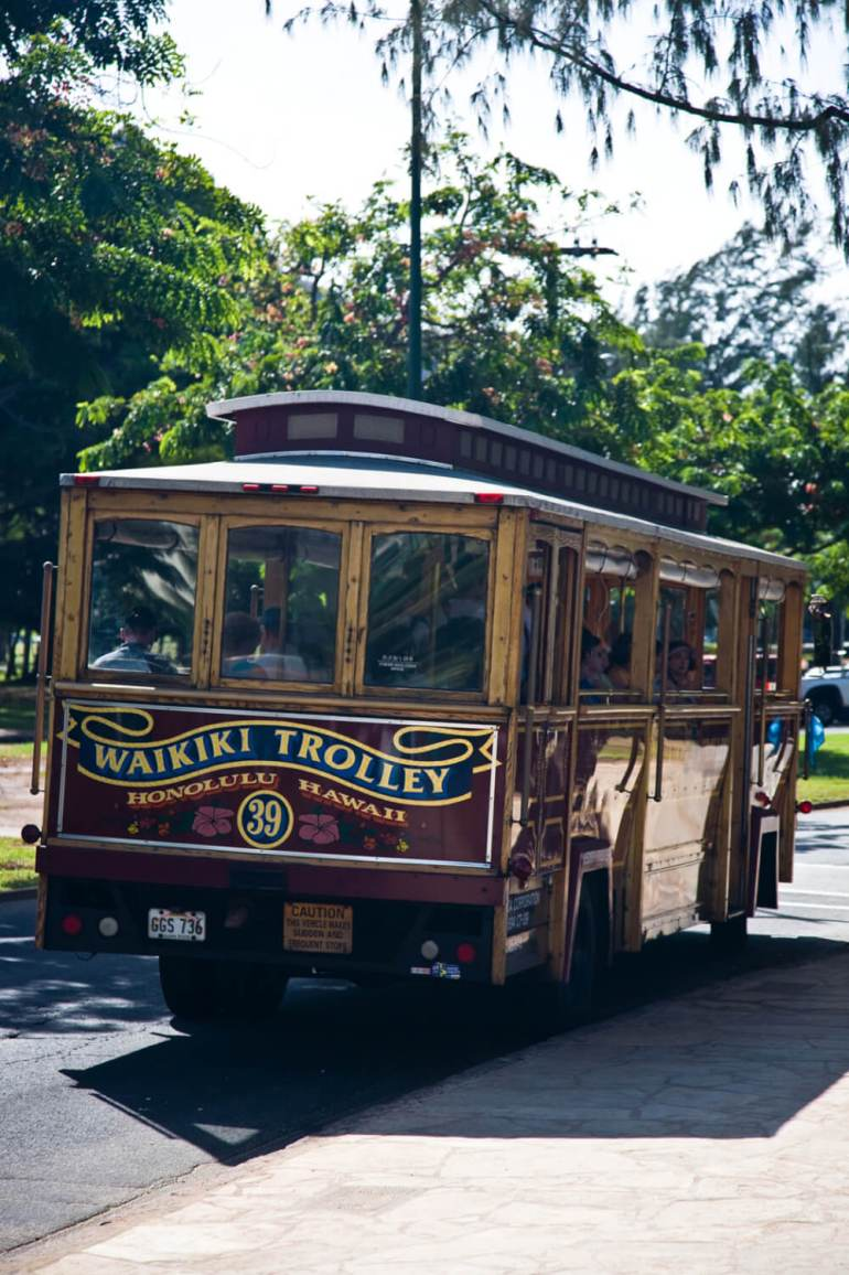 Your Complete Family Guide to Oahu with Kids featured by top Hawaii travel blog, Hawaii Travel with Kids: The Waikiki Trolley is an easy way to get around Waikiki on Oahu with kids