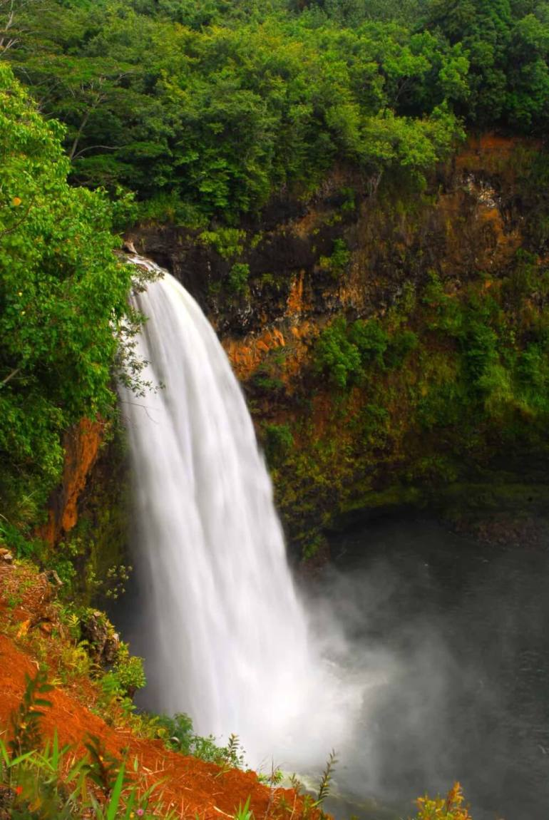 Top 11 Best Kauai Waterfalls you Should Visit featured by top Hawaii travel blog, Hawaii Travel with Kids: Wailua Falls is one of the most popular waterfalls on Kauai | waterfalls kauai | wailua falls kauai