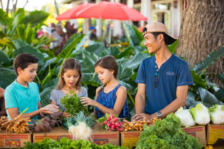 Top 25 Things to do in Poipu, Kauai featured by top Hawaii blog, Hawaii Travel with Kids: Kids at the Kauai Culinary Market at the Shops at Kukuiula on Kauai