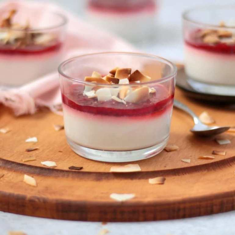 61 Delicious Coconut Dessert Recipes Perfect for Summer featured by top Hawaii blog, Hawaii Travel with Kids: Close up on the Vegan Panna Cotta on a wooden board
