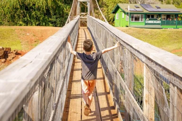 101 Best Things to Do on Kauai with Kids featured by top Hawaii blog, Hawaii Travel with Kids: Hanapepe Swinging Bridge is a fun Kauai activity for kids