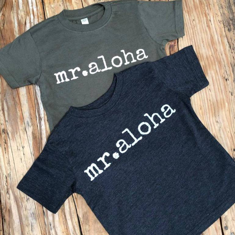 "Top 15 Best Kauai Souvenirs featured by top Hawaii blog, Hawaii Travel with Kids: Ivy & Co. printed shirts that say ""Mr. Aloha"" on them"