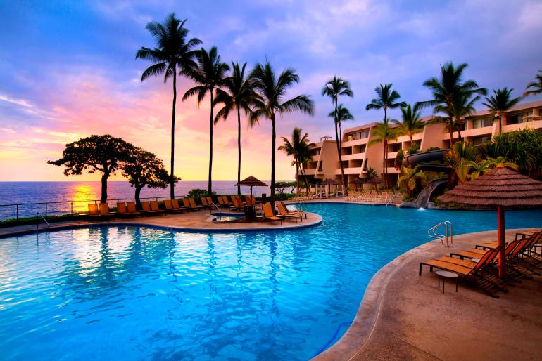 The Sheraton Kona Resort & Spa is another best place to stay on Big Island with kids. Image of the pool area overlooking the beach.