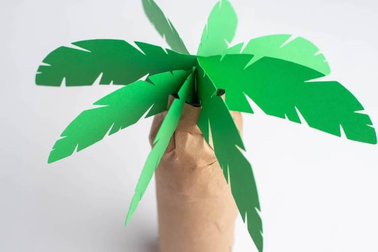 DIY Hawaiian Decorations: How to Make a Luau Palm Tree Centerpiece Using a Cricut, a tutorial featured by top Hawaii blog, Hawaii Travel with Kids.