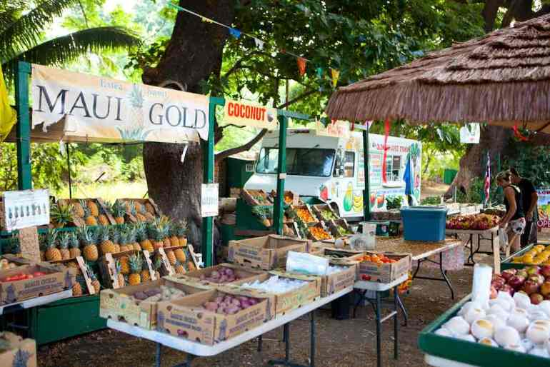 Maui Farmers Markets you need to know about by top Hawaii blog Hawaii Travel with Kids. Image of a farmers market on Maui.