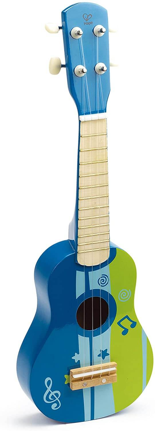 Find out the best toddler ukulele to buy in this ukulele guide by top Hawaii blog Hawaii Travel with Kids. Image of a Hape ukulele