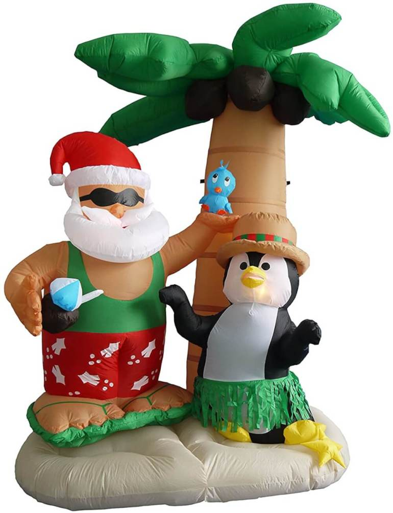 Best Hawaiian Christmas Decorations featured by top Hawaii blogger, Hawaii Travel with Kids: Add some Hawaiian Christmas decorations to your home this holiday season with these top Hawaii Christmas decorations ideas from top Hawaii blog Hawaii Travel with Kids. Image of Hawaiian Santa and Penguin Inflatable
