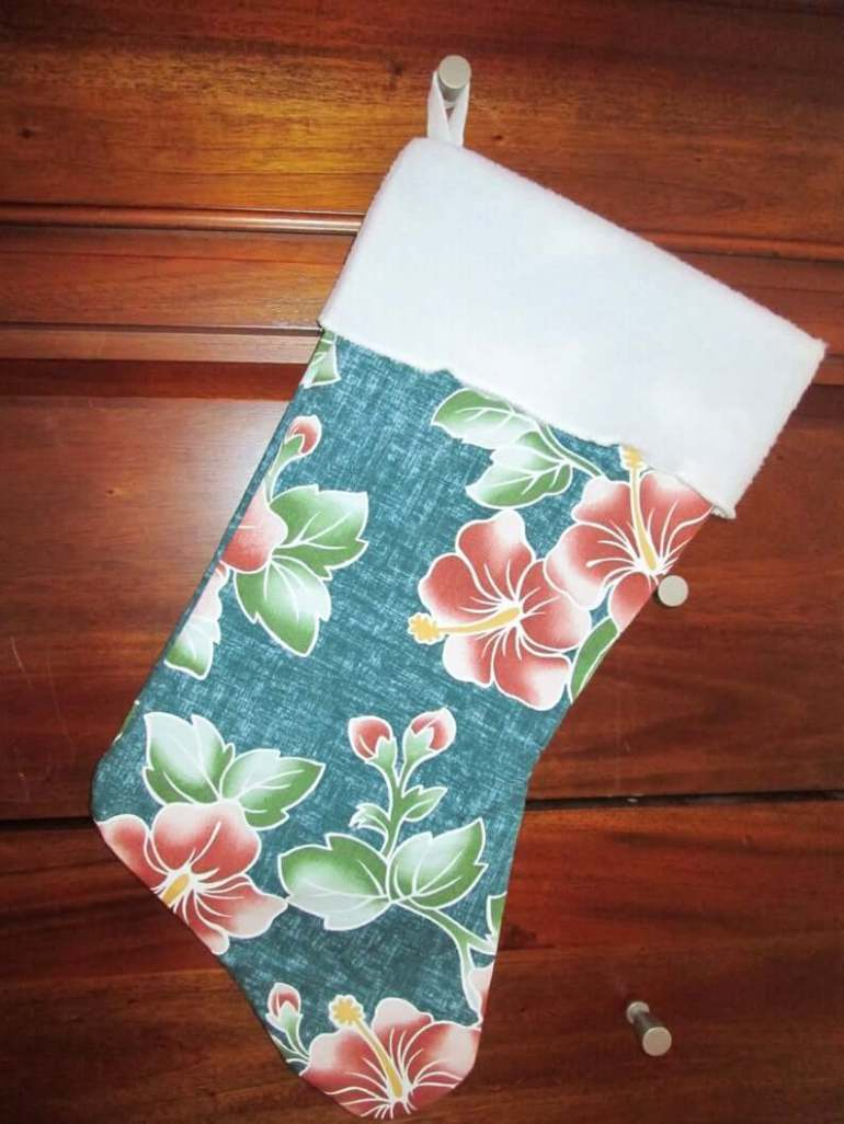 Best Hawaiian Christmas Decorations featured by top Hawaii blogger, Hawaii Travel with Kids: Add some Hawaiian Christmas decorations to your home this holiday season with these top Hawaii Christmas decorations ideas from top Hawaii blog Hawaii Travel with Kids. Image of Hawaiian Print Christmas Stocking