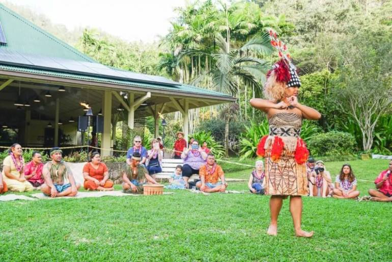 If you're looking for an authentic luau, Toa Luau in North Shore Oahu is pretty amazing. Image of a Samoan dancer performing with audience members in the background.