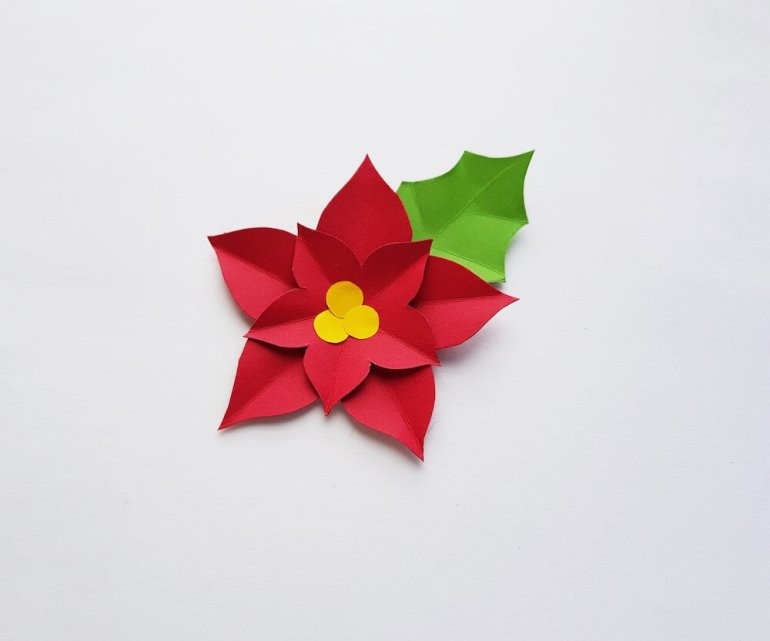 How to Make a Paper Poinsettia Craft, a tutorial featured by top Hawaii blog, Hawaii Travel with Kids: Image of a completed paper poinsettia