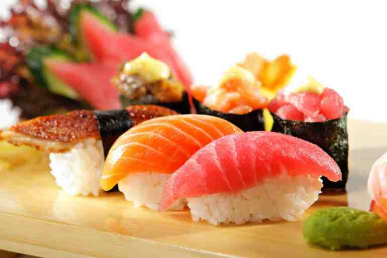 You'll want to taste this Hawaii sushi. Image of Sushi Set: Salmon, Conger and Tuna Sushi with Salad Leaf