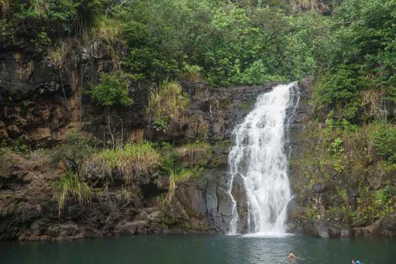 Waimea Falls is one of the best Oahu waterfalls worth checking out for military families. Image of a tropical waterfall in North Shore Oahu.