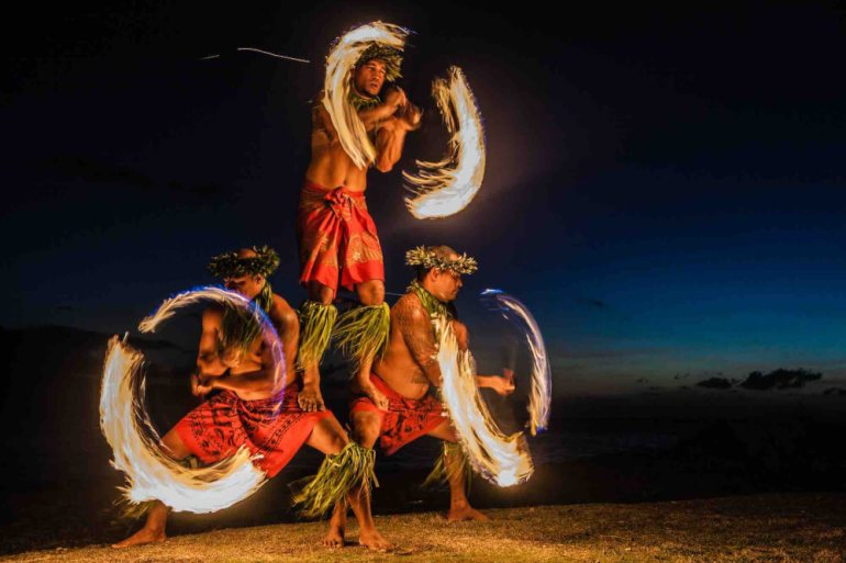 Get all your top Hawaii luau questions answered by top Hawaii blog Hawaii Travel with Kids.Image of Three Strong Men Juggling Fire in Hawaii - Fire Dancers.