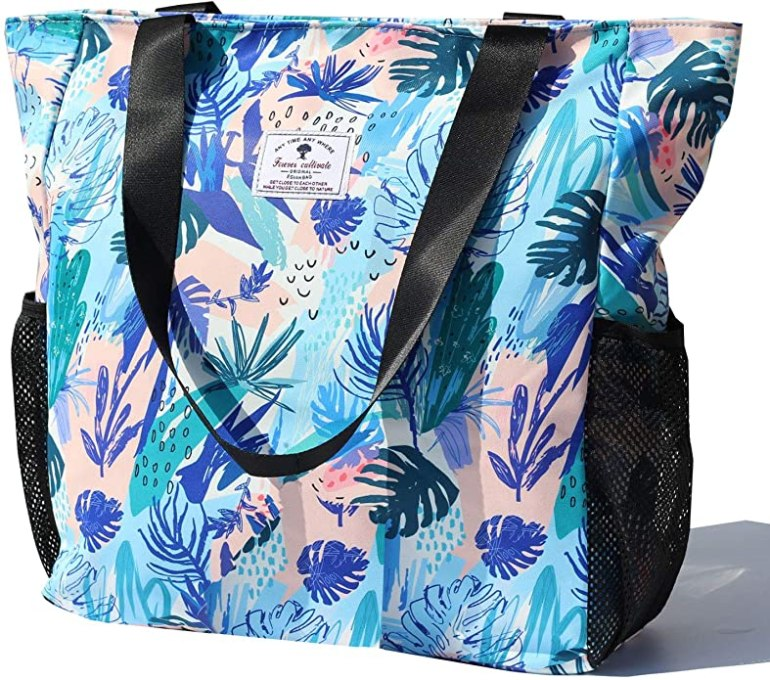 Be sure to pack a beach bag for Hawaii. Image of a blue and pink tropical beach bag.