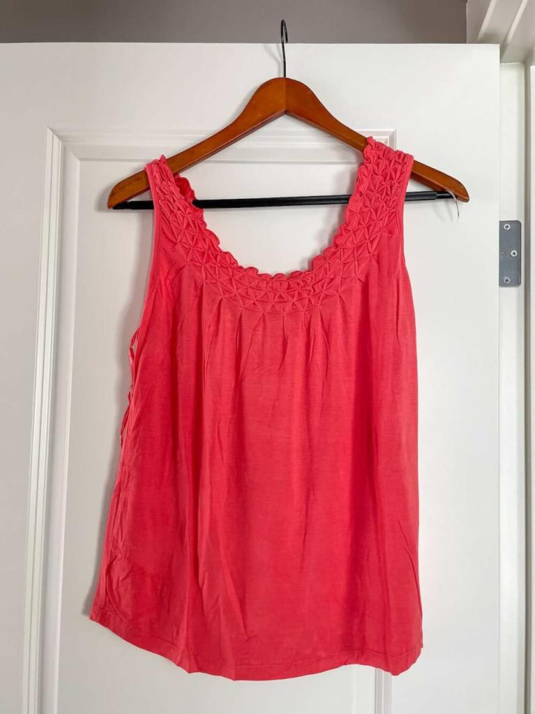 This coral pink top came in my Wantable style box when I requested amazing Hawaii outfit ideas. Image of an origami pleated tank top.