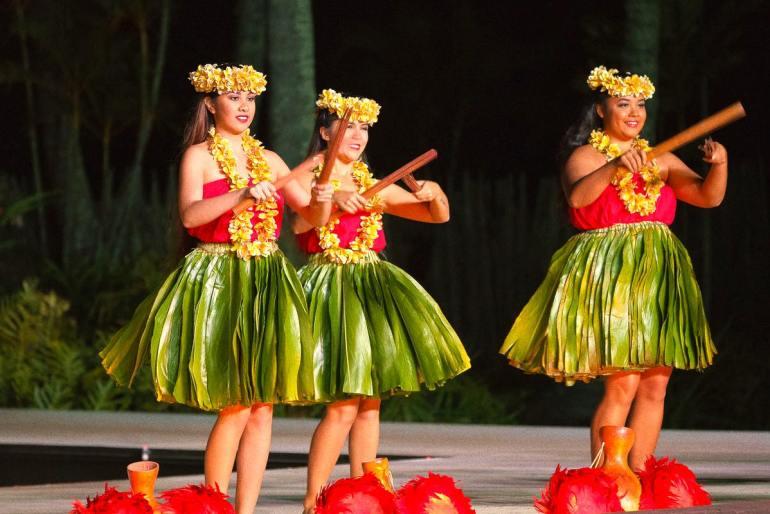 Image of hula dancers on Kauai using split bamboo hula implements.