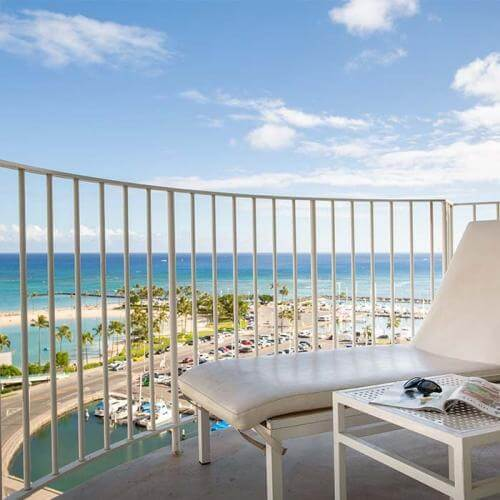 The Modern Honolulu is one of the top luxury hotels on Oahu for celebrities. Image of an oceanfront balcony.