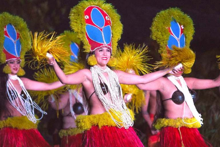 Get a detailed review of Smith's Tropical Paradise, one of the best Kauai luaus, by top Hawaii blog Hawaii Travel with Kids. Image of a group of Tahitian dancers at Smith Family Luau on Kauai.