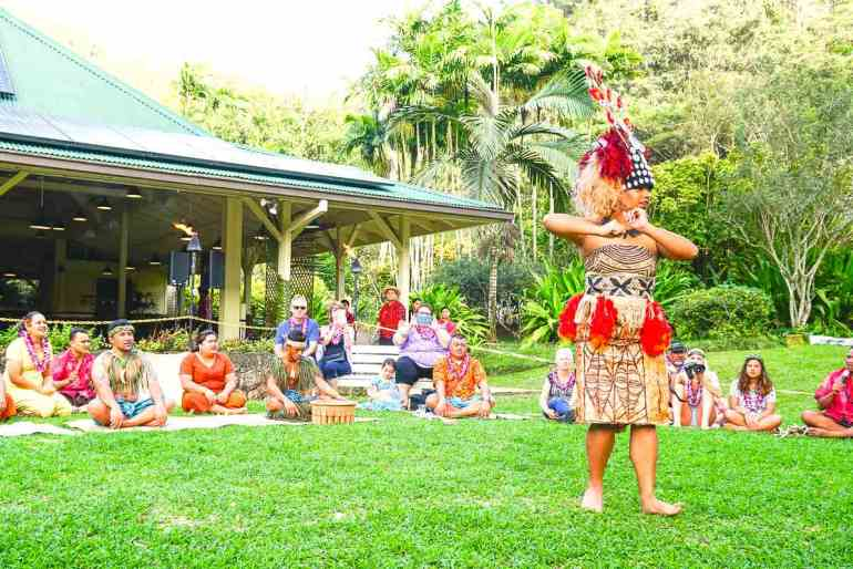 This Oahu luau features a lot of Samoan culture in addition to Hawaiian traditional dancing. Image of a Samoan princess dancing in front of a crowd.