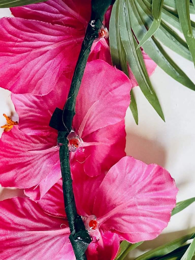 Image of pink flowers glued to a hoop wreath