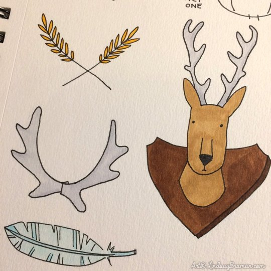 doodle of feather, wheat sheath, antlers, and a deer trophy