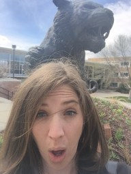 Rebecca gasps as the statue of the school's Bengal tiger looks like it's about to claw her head off.